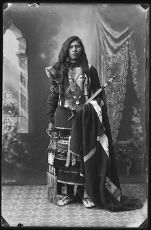 Black-and-white photographic portrait of Jimmie Sequint, a Northern Shoshone man in traditional dress.