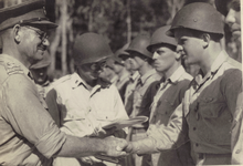 New Zealand Brigadier Leonard Goss Awards US SS Harry Stickel Air Medal on Stirling Island.png