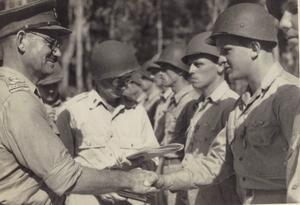 8th Brigade (New Zealand) - Brigadier Leonard Goss awards US Staff Sergeant Harry Stickel an Air Medal on Stirling Island, 2 March 1944.