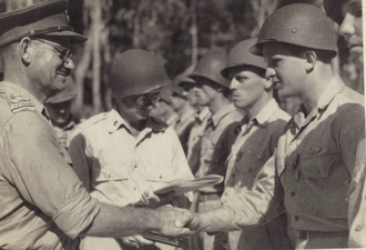 8th Brigade (New Zealand) - Brigadier Leonard Goss awards US Staff Sergeant Harry Stickel an Air Medal on Stirling Island, 2 March 1944.
