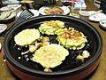 Okonomiyaki on a cooking plate by Heroic Beer in Fukui.jpg