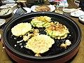 Okonomiyaki on a cooking plate by Heroic Beer in Fukui.jpg
