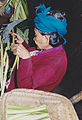 Old woman with cane works on Java.jpg