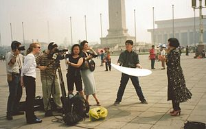Yue-Sai Kan - Yue-Sai with her production crew were filming One World in Beijing