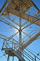 Open lattice structure of Farewell Spit lighthouse against the sun.jpg