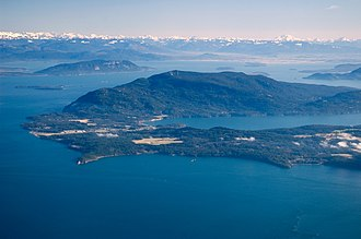 Orcas Island - Aerial view of Orcas Island with the Cascade Mountains in the background
