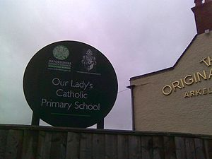 Catholic school - A sign for a Catholic school in Oxford, with the coat-of-arms of the Archdiocese of Birmingham and the logo of the Oxfordshire County Council.