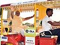 PM Modi takes e-rickshaw ride in Varanasi (26710492160).jpg