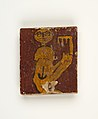 Panel with crouching figure holding a key MET 13.182.45 EGDP013800.jpg