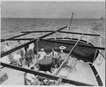 Photograph of President Truman and members of his vacation party lounging on the after deck of the U.S.S.... - NARA - 199035.tif