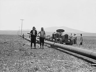 Iraq Petroleum Company - IPC assistants welding pipes together on the Esdraelon stretch in the 1930s.