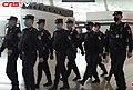 Policemen wearing masks patrolling Wuhan Tianhe Airport during Wuhan coronavirus outbreak.jpg