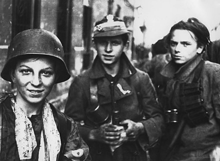 Young Radoslaw Group soldiers, 2 September 1944, a month into the Warsaw Uprising. They had just marched several hours through Warsaw sewers. Polish Boy Scouts fighting in the Warsaw Uprising.jpg