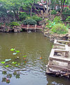 Pond corner with bridge at Yuyuan Gardens.jpg