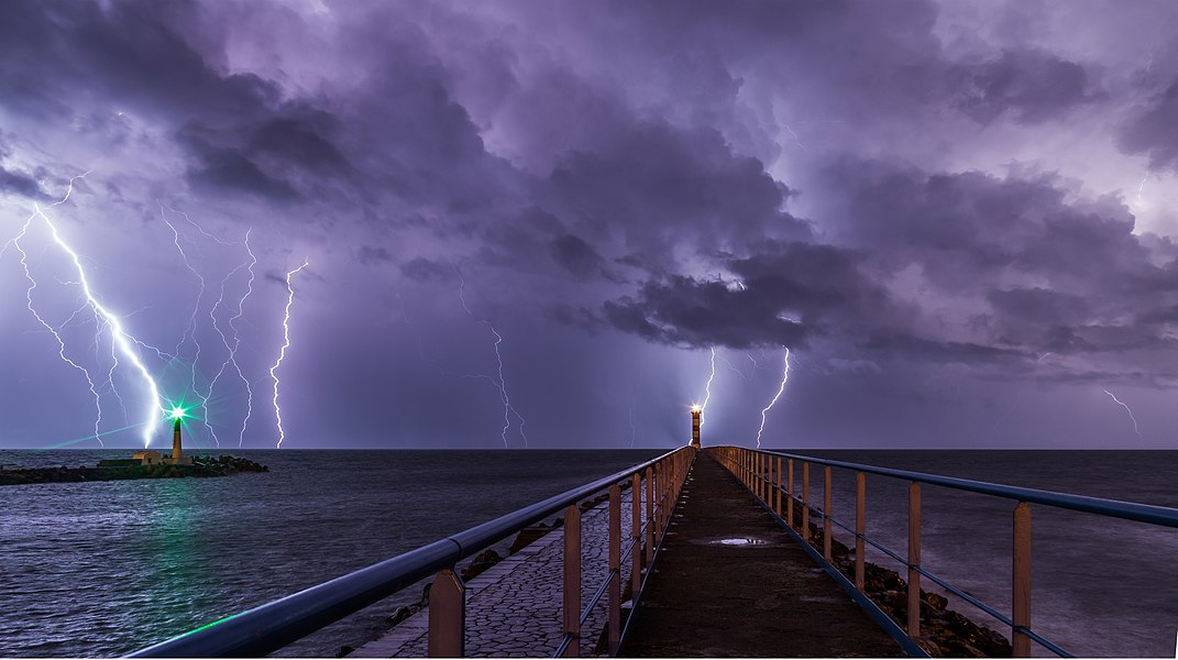Port and lighthouse in Port-la-Nouvelle in the Aude department in southern France during a thunderstorm.