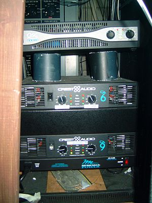 Audio power amplifier - Three rack-mounted audio power amplifiers used in a sound reinforcement system.