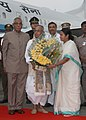 Pranab Mukherjee being received by the Governor of West Bengal, Shri M.K. Narayanan and the Chief Minister of West Bengal, Kumari Mamata Banerjee on his arrival, at NSCBI airport, in Kolkata on September 14, 2012.jpg
