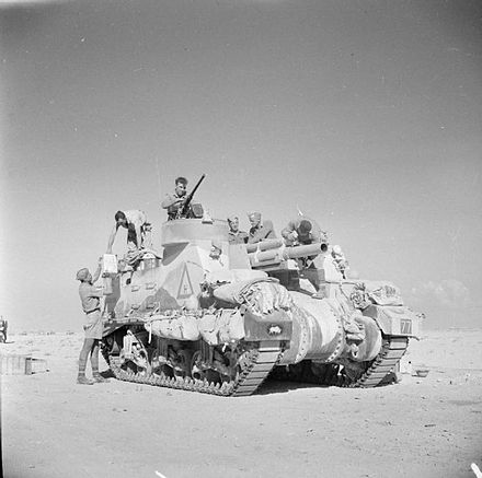 A Priest 105 mm self-propelled gun of the 1st Armoured Division preparing for action, 2 November 1942 Priest of 1st Armoured Division in North Africa, 2 November 1942 (E 18869).jpg