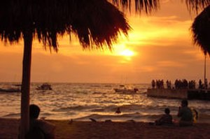 Puerto Vallarta - Sunset on Los Muertos beach in Olas Altas, Col Zapata.