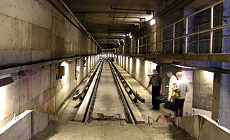 Roll way - View of a track from a sand drag bumper post, in the Montreal Metro near the Beaugrand Station, showing the cross-section of guide bars, precast concrete roll ways and conventional track.
