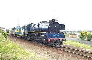 West Coast Railway (Victoria) - R711 leads a steam-hauled West Coast Railway service out of Warrnambool station in 2001