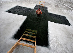 Winter swimming - An ice hole is cut in the form of a cross in Russia to celebrate the Epiphany