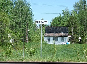 Redwater, Ontario - Flat-roofed building and locality sign in Redwater