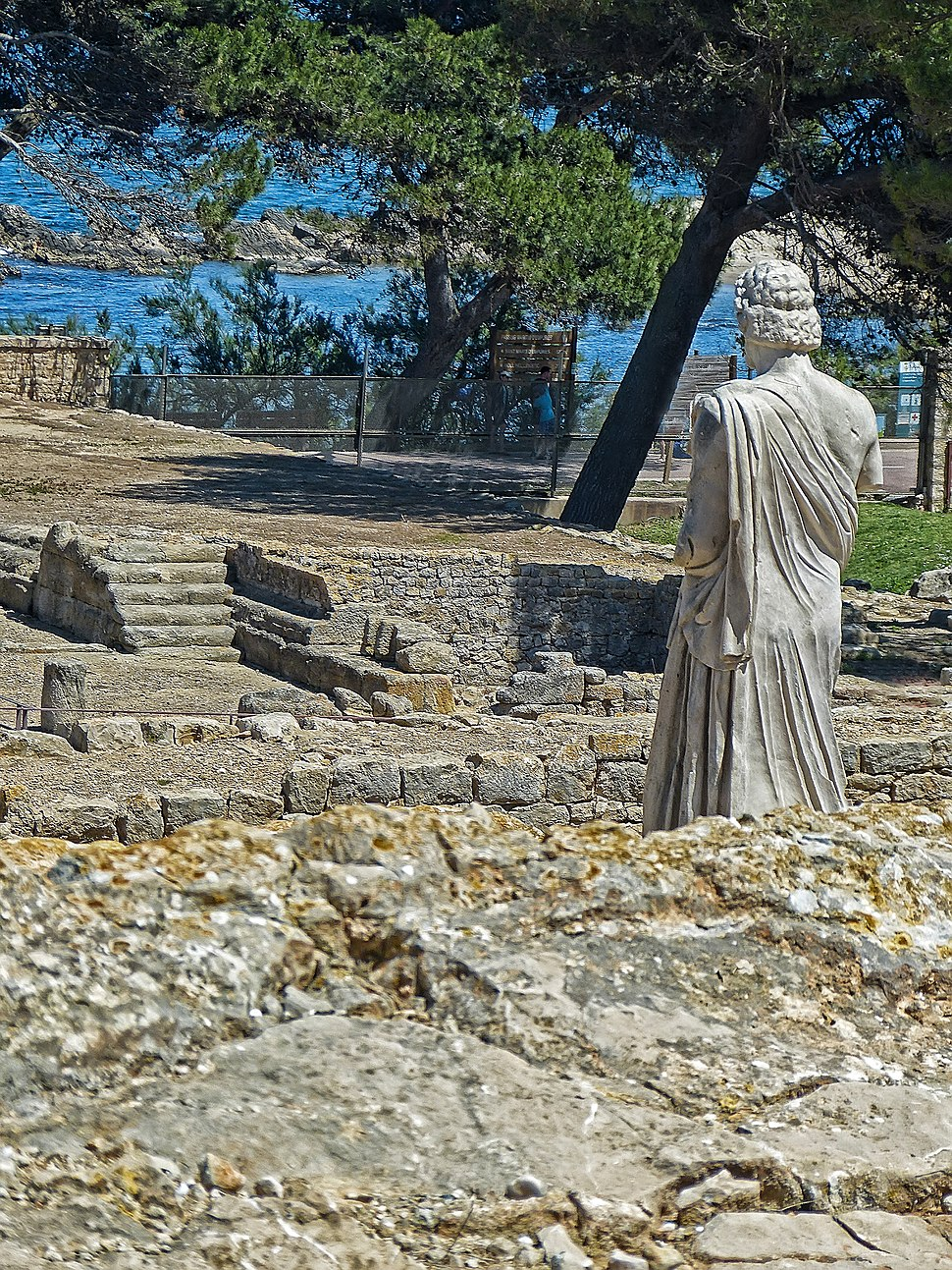 Remains of ancient Greek city of Neapolis with reproduction of Aesclepius at the archaeological site of Empúries