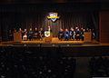 Retired U.S. Navy Adm. Henry Mauz, at the lectern, delivers the keynote address at a Naval Postgraduate School graduation ceremony March 29, 2013, at the school in Monterey, Calif 130329-N-OH194-170.jpg