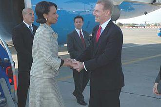 Craig A. Kelly - Craig A. Kelly greets Condoleezza Rice upon arrival in Santiago International Airport, April 28, 2005
