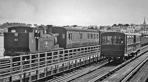Isle of Wight Railway - Ryde Pier with a steam train and electric tramcar