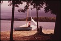 SAILBOAT BEACHED AT RAQUETTE LAKE, NEW YORK, IN THE ADIRONDACK FOREST PRESERVE - NARA - 554486.tif