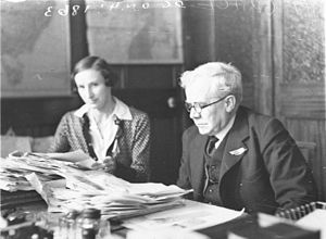 Grace Bros. - Albert Edward Grace, the head of Grace Bros department store and his secretary in his office