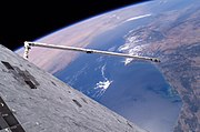 STS-114 Discovery's underside floats over the Earth in this first-of-its-kind view
