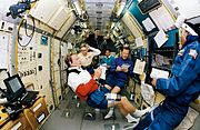 STS-47 crew in SLJ make notes during shift changeover