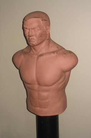 """Punching bag - A """"body opponent bag"""" on a pedestal mount"""