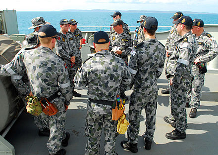 Royal Australian Navy sailors in 2010 Safety briefing aboard HMAS Tobruk in 2010.jpg