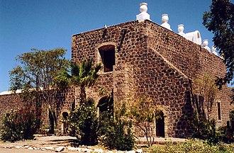 Misión Santa Rosalía de Mulegé - Stone facade and buttress.