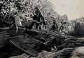 Sarawak; four Dayak tribesmen in a warfare ritual. Photograp Wellcome V0037456.jpg