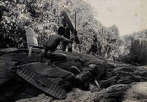 Antiarin - Sarawak; four Dayak tribesmen in a warfare ritual. Photograph Wellcome V0037456