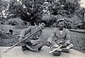Sarawak; native musicians playing on a nose flute and fiddle.jpg