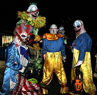 Evil clown - A group of people in evil clown costumes at a PDC 2008 party at Universal Studios