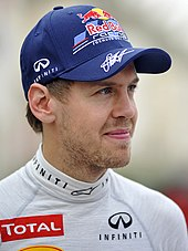 A picture of Sebastian Vettel donning Red Bull Racing attire.