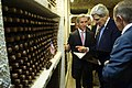 Secretary Kerry Examines a Certificate as the Moldovans Designate a Bin of Wine in His Honor (11211930044).jpg