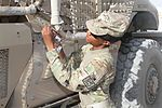 Signals NCO adjusts in Afghanistan 131023-A-MH103-952.jpg