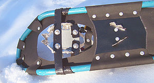 Underside of a modern fixed-rotation binding snowshoe, showing cleats for traction on steep slopes Snowshoe reverse.jpg