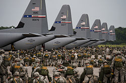 Soldiers from the US Army's 82nd Airborne Division prepare for a mass parachute jump from US Air Force C-130J Hercules aircraft during a Joint Operation Access exercise at Pope Field in 2013.