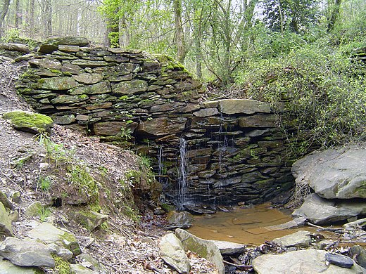 Ruins of the paper mill at Sope Creek Sope Creek pulp mill retaining wall ruin.jpg