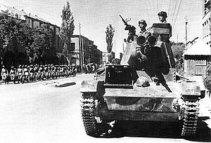 Anglo-Soviet invasion of Iran - Soviet tankmen of the 6th Tank Division drive through the streets of Tabriz on their T-26 light tank.