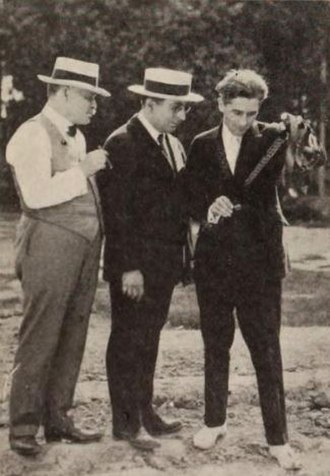 """John M. Stahl - Still from the Sowing the Wind with film producers William Nicholas Selig and Louis B. Mayer and director John M. Stahl examine the film from one """"take"""""""